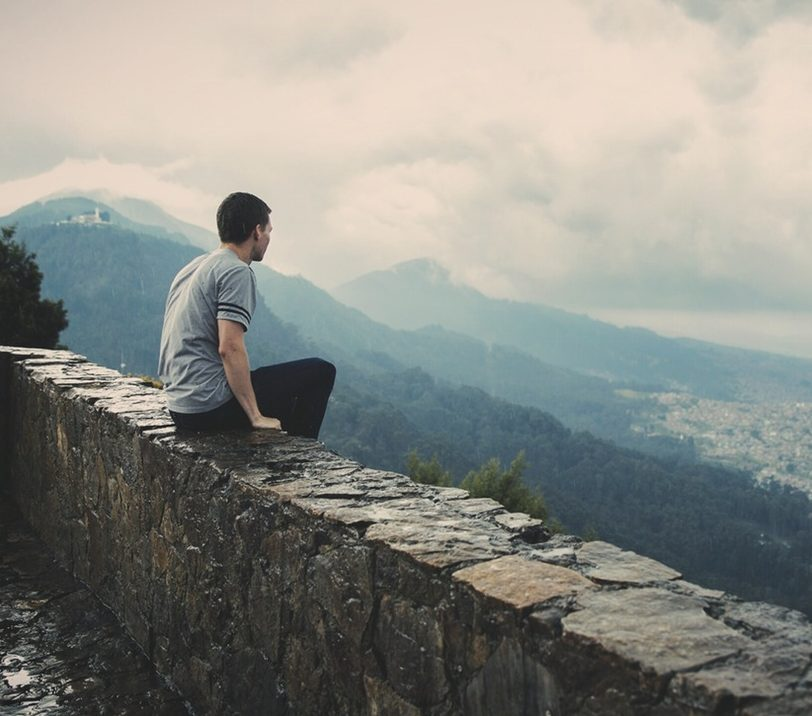 man-person-wall-sitting